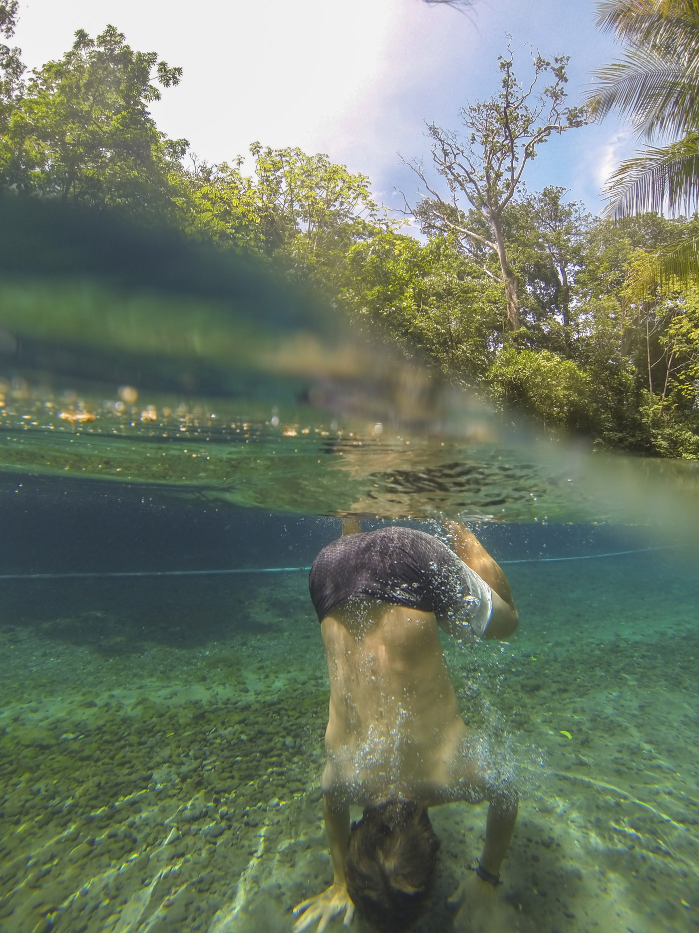 Me setting up for a handstand in the clear water