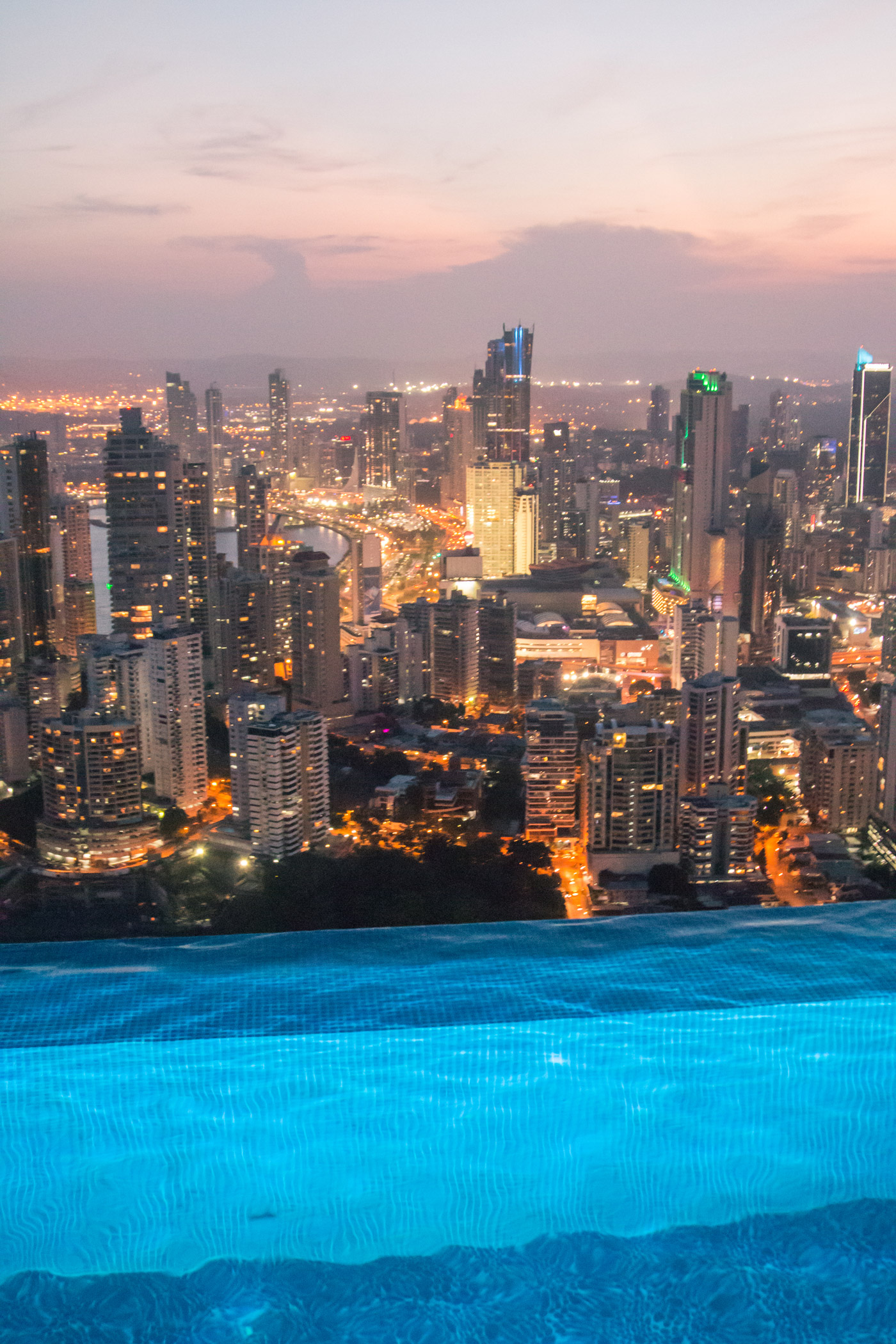 The city lights from the pool